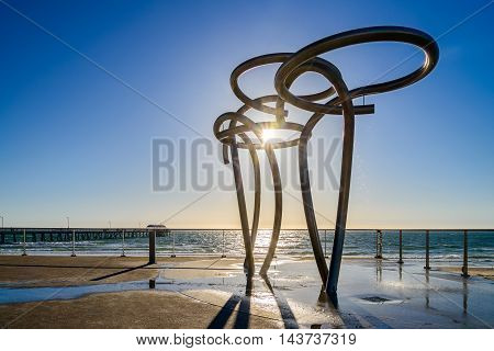 Public showers at Henley Beach with jetty at the background South Australia