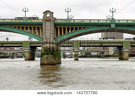 View of Bridges Along the Thames River London England. Southwark bridge and Cannon Street Railway Bridge London Bridge Tower Bridge.