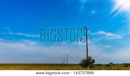 power line to the village in a field.
