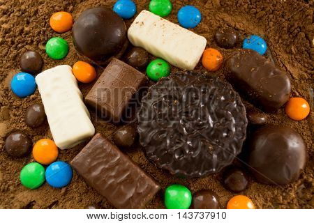 scattering of candy with cocoa powder,  chocolate