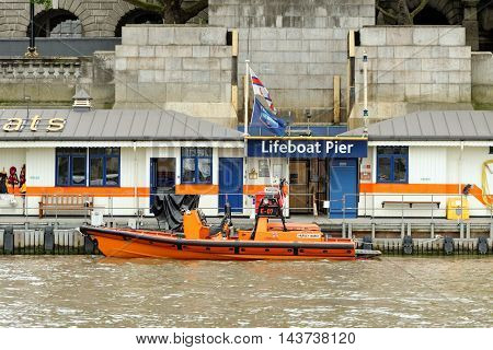 LONDON ENGLAND - JULY 8 2016: A view of the Tower RNLI station positioned on the north bank of the river Thames. The RNLI formed in 1824 currently has around 40000 volunteers