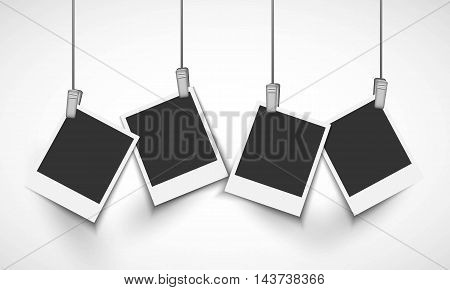 Blank photo frame hanging on a line with metallic clip