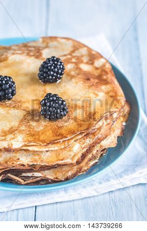 Crepes With Blackberries On The Wooden Table