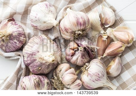 The fresh garlic on kitchen table.