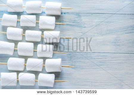 Marshmallow Skewers On The Wooden Background