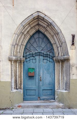 Blue wooden door in old town of Tallinn. Estonia Europe