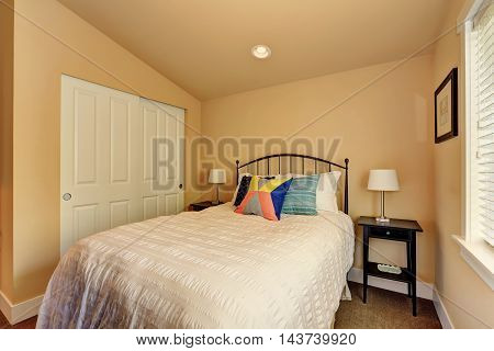 Small Beige Bedroom Interior With White Bed And Closet.