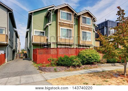 American Duplex House For Two Families. Green Exterior Paint
