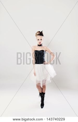 beautiful Fashionable Woman Standing on White Background