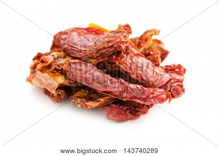 Tasty dried tomatoes isolated on white background.