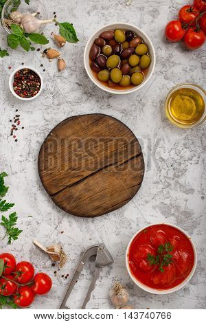 Italian food cooking ingredients with wooden blank board on white background top view