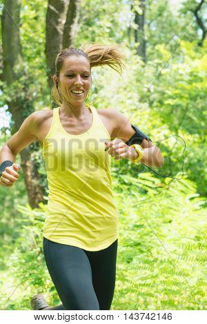 Female running with smile, vertical image, color image