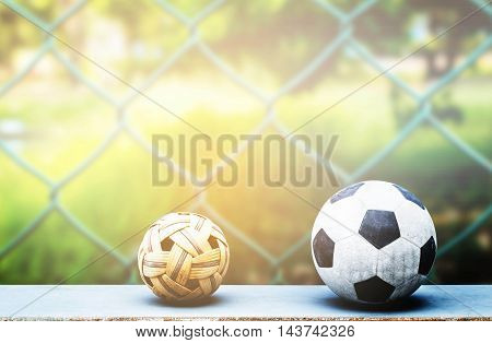 ball on a wooden with the back of the net.