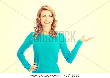 Woman showing something or copyspase