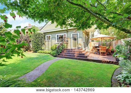 Backyard Area With Walkout Deck And Well Kept Lawn.