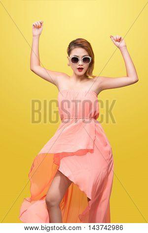 beautiful young asian woman in nice spring dress posing in studio. Fashion photo