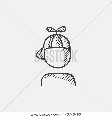 Boy in cap with propeller sketch icon for web, mobile and infographics. Hand drawn vector isolated icon.