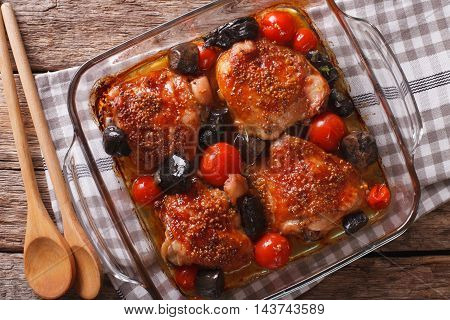 Baked Chicken Thigh With Mustard, Tomatoes And Wild Mushrooms Close Up. Horizontal Top View