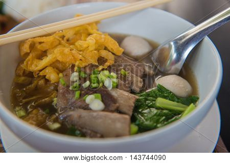 noodles with boiled pork on table in restaurant