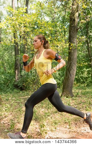 Young woman jogging in park, vertical image, color image