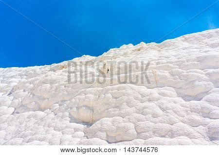 White wall on travertines Pamukkale in Turkey