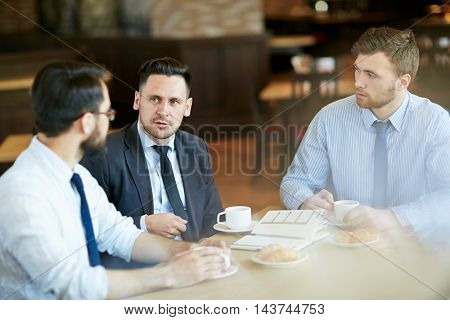Discussing Work in Cafe