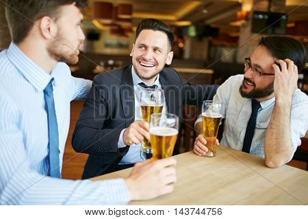 Coworkers Enjoying Beer