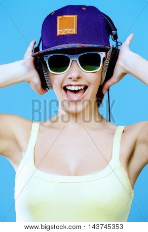 Modern girl enjoys listening to music in headphones. Positive emotions, leisure.