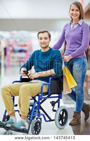 Young Man in Wheelchair Shopping with Wife
