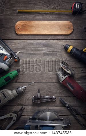 Electric hand tools (screwdriver Drill Saw jigsaw jointer) photo processing: instagram, top view above, copy space