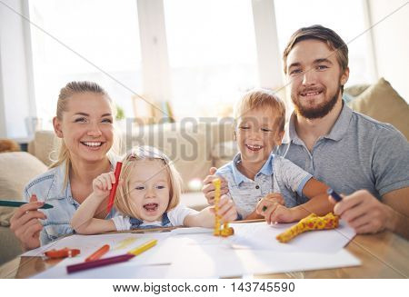 Young Family Playing in Apartment