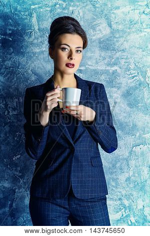 Portrait of a beautiful business lady wearing formal suit. Business style, fashion.