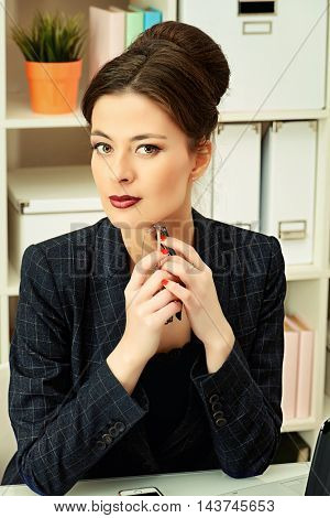 Businesswoman working at the office. Business, education.