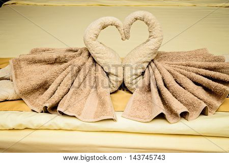 Bed suite decorated with towels in hotel