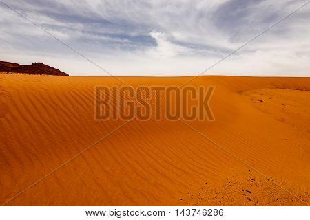 Sand dunes under dramatic sky Wadi Rum Jordan. concept of global warming.