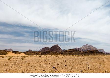 Wadi rum desert landscape and cloudy sky Jordan