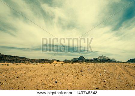Wadi rum desert landscape with dramatic sky,  Jordan