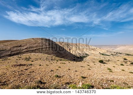 Mountain landscape with cloudy sky in Jordan desert.