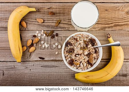 oatmeal with banana nuts and milk for breakfast top view.