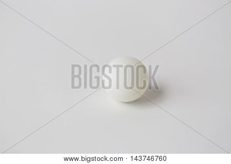 sport, fitness, game, sports equipment and objects concept - close up of ping-pong or table tennis ball over white background