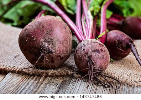 Young beets on rustic wooden table.  diet cooking.
