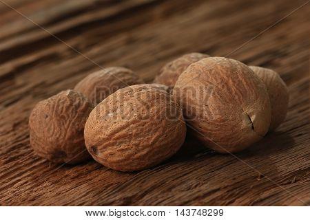 nutmeg on an old table, studio shot