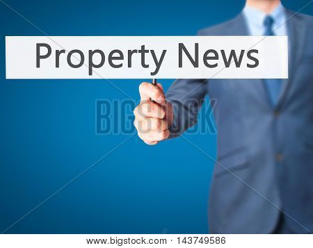Property News - Business Man Showing Sign