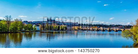 Panorama view of Charles bridge over Vltava river and Gradchany (Prague Castle) and St. Vitus Cathedral in the Prague, Czech Republic
