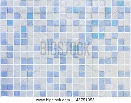 Closeup surface tiles pattern at blue tiles in bathroom wall texture background