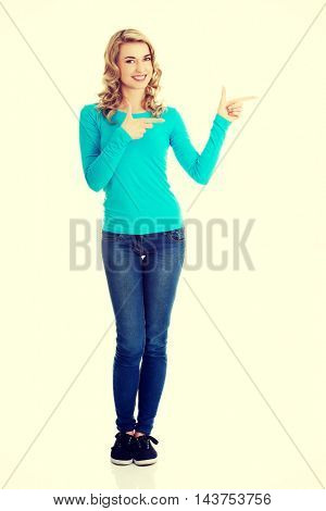 Woman pointing on copy space.