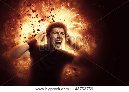 Young Man listening to music with headphones on dark exploding  background