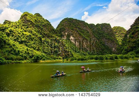 Ninh Binh, Vietnam - 02 June, 2013: The tourist go in the river on the boat for sightseeing