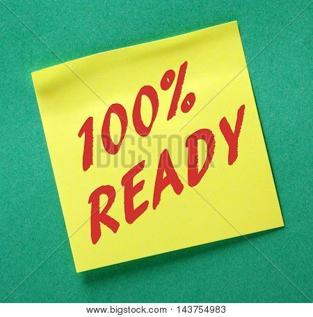 The phrase 100% Ready in red text on a yellow sticky note as a reminder to be prepared