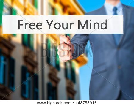 Free Your Mind - Business Man Showing Sign